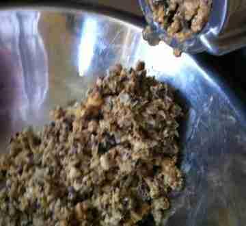 Grinding ingredients for frozen fish food.